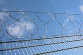 Barbed wire on a fence — Stock Photo