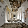 Stock Photo: Long corridor in abandoned office building