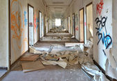 Long corridor in an abandoned office building — Stock Photo