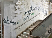 A dilapidated staircase in an abandoned building — Stock Photo