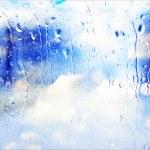 Rain running down glass window — Stock Photo