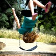 Stock Photo: Girl Swinging Upside Down