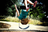 Girl Swinging Upside Down — Stock Photo