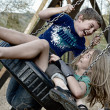 Boy and Girl Swinging On a Tire — Stock Photo