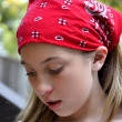 Stock Photo: Sad adolescent girl wearing red bandana