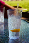 Iced water glass with lemon — Stock Photo