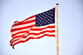 American Flag On Pole Blowing In Wind — Stock Photo