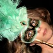 Stock Photo: Beautiful WomWearing Masquerade Mask