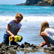 Girls At The Beach Making Sand Castle — Stok fotoğraf