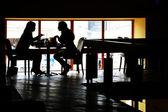 Conversation at restaurant — Stock Photo