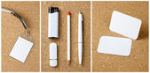 White collection of stationery on corkboard background. — Stock Photo