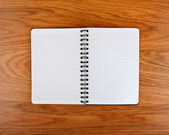 Notepad with a spiral binding and checkered sheets — Stock Photo