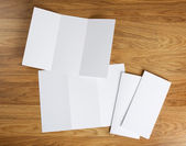 Blank white folding paper flyer — Stock Photo