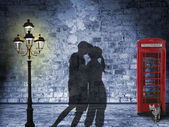Kissing couple silhouette in the streets of london — Stock Photo
