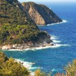 Picturesque rocky coast of elba island, italy - Stock Photo