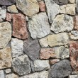 Stonewall of virgin stones, natural background — Stock Photo