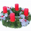 Advent wreath with four candles and silver ribbon - Stock Photo