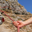 Mountain climber holding on a climbing rope — Stock Photo #22587471