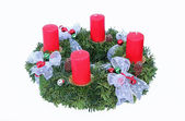 Advent wreath with four candles and silver ribbon — Stock Photo