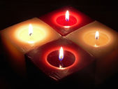 Four burning candles, atmospheric christmas decoration — Stock Photo