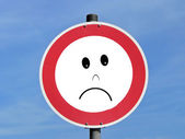 Sad road traffic sign — Stock Photo