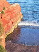 Sandy rocks at Jurassic Coast, South England — Stock Photo