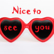 "Heart shaped eye glasses with text ""Nice to see you"" — Stock Photo"