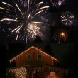 Illuminated barn and fireworks — Stock Photo