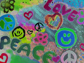 "Teenager drawing ""love and peace"" — Stock Photo"
