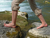 Mountain creek and girls feet, doing kneippism — Stock Photo