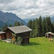 Wooden mountain shelter in the austrian alps, against dramatic sky — Stock Photo #26233661
