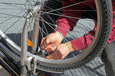 Closeup of a man, doing bicycle repairs and maintenance — Stock Photo