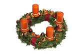 Advent wreath with cinnamon candles, golden cones and ribbon — Stock Photo