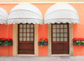 Two entrances with nostalgic marquee, italy — Stock Photo