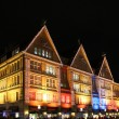 Illuminated facade of big stores in strip mall of munich, christmas decoration — Stock Photo #31165795