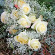 Stock Photo: Mourning bouquet of white roses and gypsophila