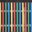 Kindergarten fence in vivid colors — Stock Photo