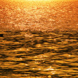 Rippled water background at sunset — Stock Photo