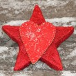Hand made felt heart and red star on snowy firewood logs, christmas decoration — Stockfoto