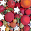 Christmas background with apples, cookies, and baubles — Stock Photo