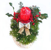 Advent spray with red candle, golden ribbon and holly branch wit — Zdjęcie stockowe