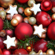 Christmas background with apples, cookies, nuts and baubles — Stock Photo