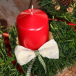 Stock Photo: Christmas decoration with red candle and jew branches on tree tr