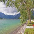 Walkway at the lakeside of achensee, with red bench — Stock Photo