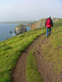 Man walking on a coastal hiking path, south england — Stock Photo