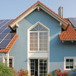 Modern new built house and garden, rooftop with solar cells — Stock Photo