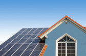 Modern new built house, rooftop with solar cells, blue front wit — Stock Photo
