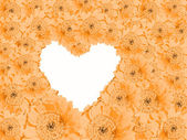 Background of pastel colored orange gerber daisies and heart sha — Stock Photo