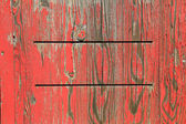 Painted wooden background with exfoliated red color — Stock Photo