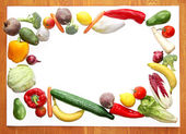 Board with fresh vegetable and fruit border — Stock Photo
